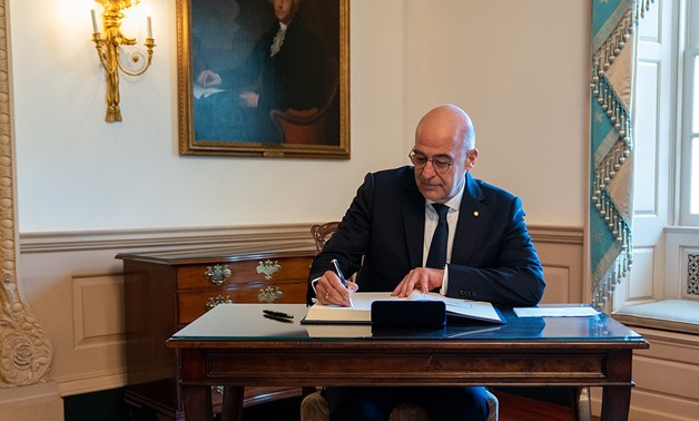 Greek Foreign Minister Nikos Dendias signs Secretary Pompeo's guestbook before their meeting at the U.S. Department of State in Washington, D.C., on July 17, 2019. [State Department photo by Ron Przysucha/ Public Domain] Via Commons Wikimedia