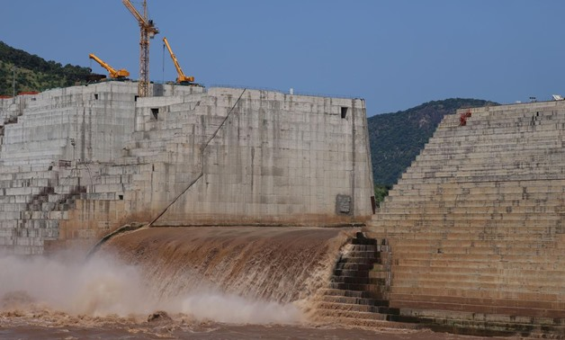 FILE PHOTO: Water flows through Ethiopia's Grand Renaissance Dam as it undergoes construction work on the river Nile in Guba Woreda, Benishangul Gumuz Region, Ethiopia September 26, 2019. REUTERS/Tiksa Negeri