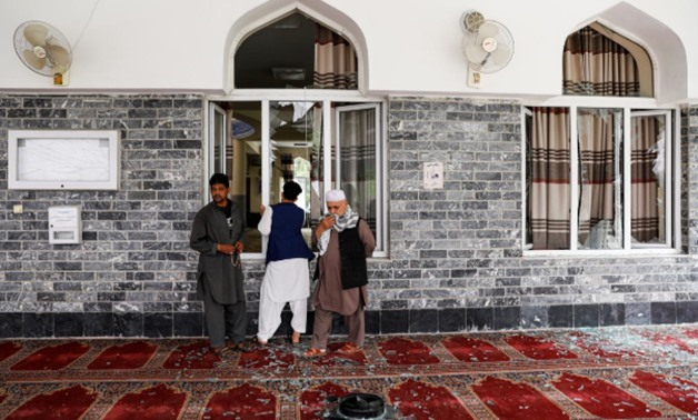 Men inspect the site of a blast inside a mosque in Kabul, Afghanistan June 12, 2020.REUTERS/Mohammad Ismail