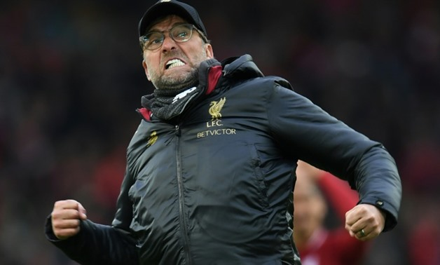 AFP/File / Paul ELLIS Jurgen Klopp has told Liverpool fans to cheer them to the title from home  Jurgen Klopp has told Liverpool fans to cheer them to the title from home
