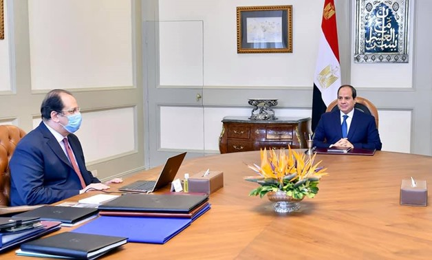 Egyptian President Abdel Fattah El Sisi (R) on Thursday discussed with intelligence chief Abbas Kamel (L) the latest updates of the Libyan crisis