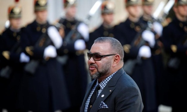 FILE PHOTO - Morocco's King Mohammed VI arrives for a lunch at the Elysee Palace as part of the One Planet Summit in Paris, France, December 12, 2017. REUTERS/Philippe Wojazer