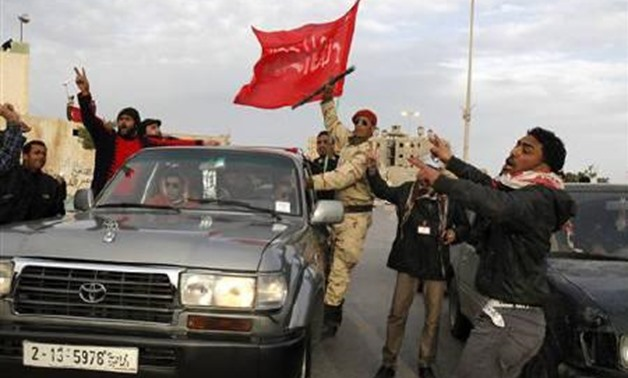 Protesters chant anti-government slogans in Tobruk February 22, 2011. REUTERS/AsmaaWaguih