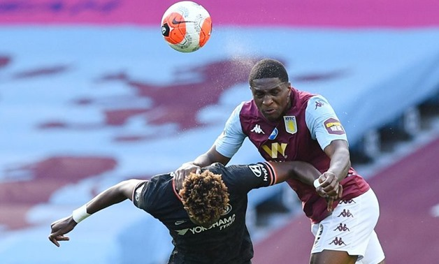 Soccer Football - Premier League - Aston Villa v Chelsea - Villa Park, Birmingham, Britain - June 21, 2020 Chelsea's Tammy Abraham in action with Aston Villa's Kortney Hause, as play resumes behind closed doors following the outbreak of the coronavirus di