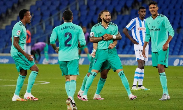 Soccer Football - La Liga Santander - Real Sociedad v Real Madrid - Reale Arena, San Sebastian, Spain - June 21, 2020 Real Madrid's Karim Benzema celebrates scoring their second goal with teammates, as play resumes behind closed doors following the outbre