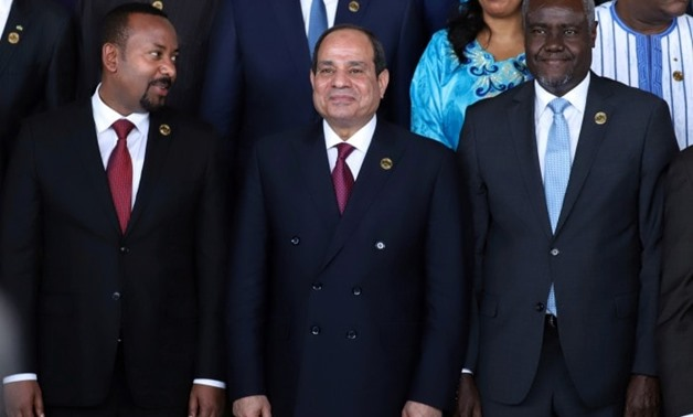 From left, Ethiopia's Prime Minister Abiy Ahmed, Egyptian President Abdel Fattah El Sisi and African Union Commission Chairperson Moussa Faki Mahamat at the opening of the 33rd Ordinary Session of the Assembly of the Heads of State and the Government of t