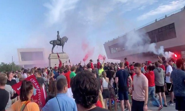 Soccer fans gather at Liverpool's Pier Head, during the novel coronavirus pandemic, celebrating Liverpool FC winning the Premier League title, in Britain June 26, 2020 in this still image taken from social media video. Content filmed June 26, 2020. Paul K