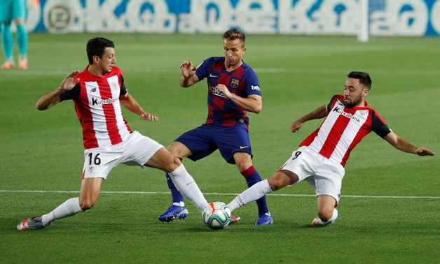 FILE PHOTO: Soccer Football - La Liga Santander - FC Barcelona v Athletic Bilbao - Camp Nou, Barcelona, Spain - June 23, 2020 Barcelona's Arthur in action with Athletic Bilbao's Mikel Vesga and Unai Lopez, as play resumes behind closed doors following the