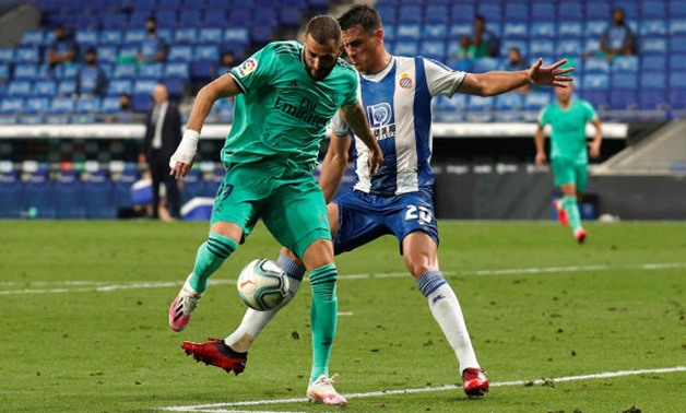 Soccer Football - La Liga Santander - Espanyol v Real Madrid - RCDE Stadium, Barcelona, Spain - June 28, 2020 Espanyol's Bernardo Espinosa in action with Real Madrid's Karim Benzema, as play resumes behind closed doors following the outbreak of the corona