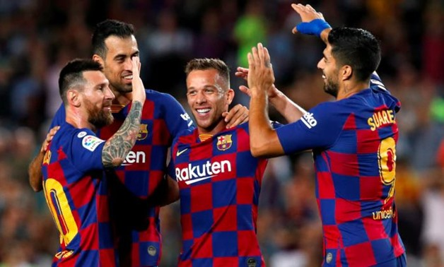 FILE PHOTO: Soccer Football - La Liga Santander - FC Barcelona v Villarreal - Camp Nou, Barcelona, Spain - September 24, 2019 Barcelona's Arthur celebrates scoring their second goal with Lionel Messi and Luis Suarez REUTERS/Albert Gea
