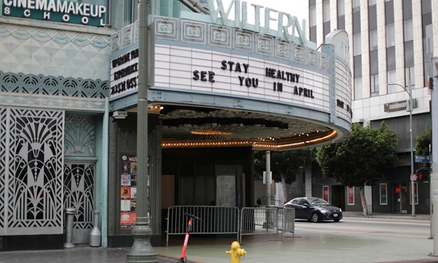 FILE PHOTO: A theater displays a closed sign during the global outbreak of coronavirus (COVID-19) in Los Angeles, California, U.S., March 16, 2020. REUTERS/Lucy Nicholson/File Photo.