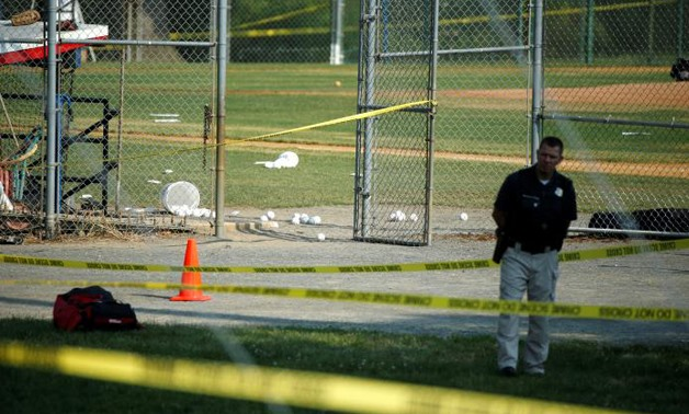 A police officer mans a shooting scene after a gunman opened fire on Republican members of Congress during a baseball practice near Washington in Alexandria, Virginia, June 14, 2017 - REUTERS