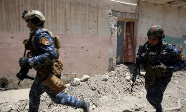 Iraqi forces advance towards Mosul's Old City on Sunday, during the ongoing offensive by Iraqi forces to retake the last district still held by the Islamic State group - AFP/Getty Images/Ahmad Al-Rubaye/