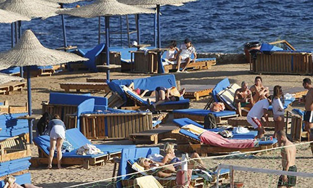 Tourists Enjoy The Sunny Weather At The Beach Of The Red Sea Resort Town Of Sharm El-Sheikh - AFP/Mohammed Abed