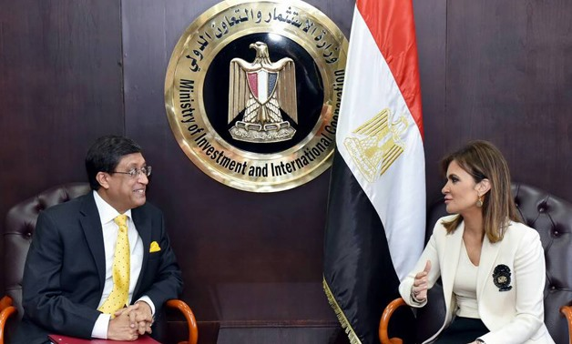 Minister of Investment and International Cooperation Sahar Nasr (R) and Indian Ambassador Sanjay Bhattacharyya (L) in a meeting on Wednesday - Press Photo