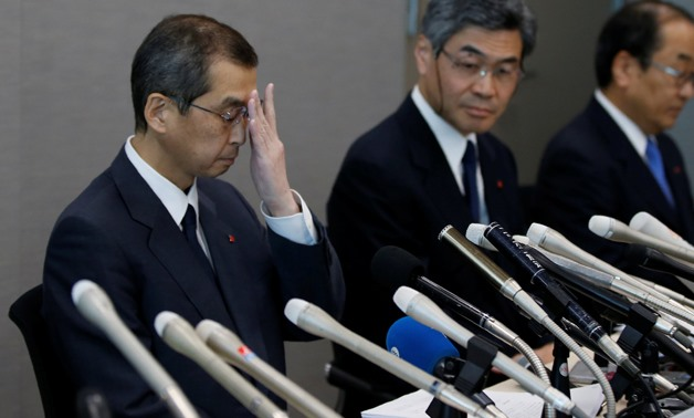 Takata Corp. Chairman and CEO Shigehisa Takada (L) and company senior officials attends a news conference after its decision to file for bankruptcy protection in Tokyo, Japan, REUTERS/Toru Hanai