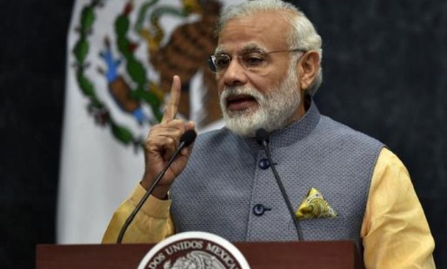 "Prime Minister Narendra Modi held a special midnight session of parliament to launch the new goods and services tax (GST) which he called ""good and simple"". PHOTO: AFP"