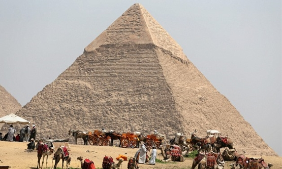 FILE – People gathering at the Giza Pyramids