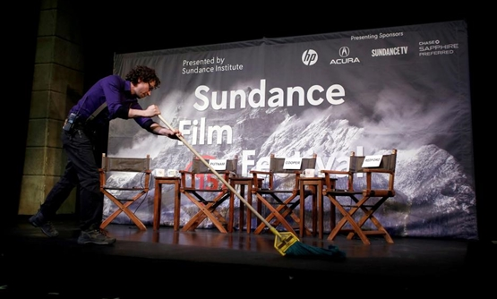 FILE PHOTO: Kevin Kane prepares the stage at an opening day news conference for the Sundance Film Festival in Park City, Utah, U.S. January 22, 2015. REUTERS/Jim Urquhart/File Photo