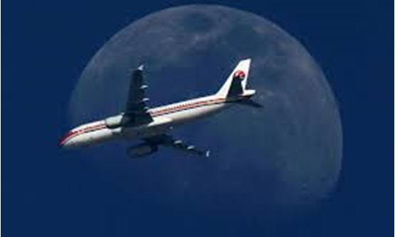 FILE PHOTO - A China Eastern Airlines passenger jet passes in front of the moon over Shanghai May 13, 2011. REUTERS/Aly Song/File Photo