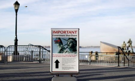 A sign announcing the closure of the Statue of Liberty sits near the ferry dock to the Statue of Liberty at Battery Park, New York, Jan. 20, 2018. REUTERS