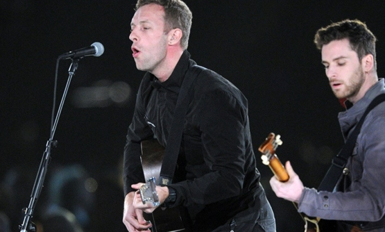 Chris Martin (L), shown performing in 2012 with Coldplay bandmate Guy Berryman, is planning a Buenos Aires concert as part of efforts to reduce poverty.