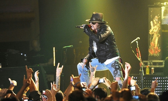 Singer Axl Rose of Guns N' Roses, shown at a 2012 performance, reunited with guitarist Slash in 2016 for a tour that has been repeatedly extended.