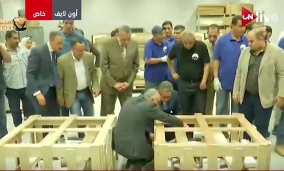 TV Screenshot of the sixth and the last chariot of Tutankhamun after arriving at the Grand Egyptian Museum on May 5, 2018.