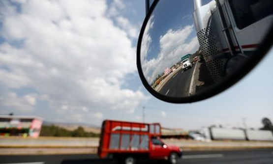 A truck is reflected in a rear-view mirror at Mexico-Puebla highway - Reuters