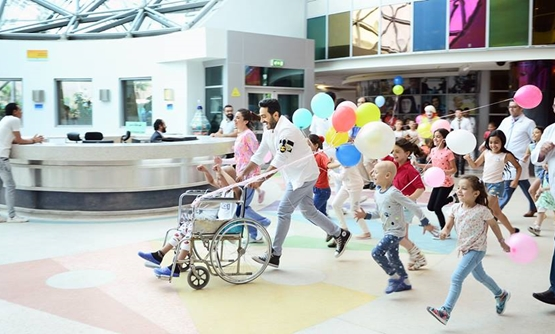 Tamer Hosny along with the children of 57357 hospital – Tamer Hosny Official Facebook Page.