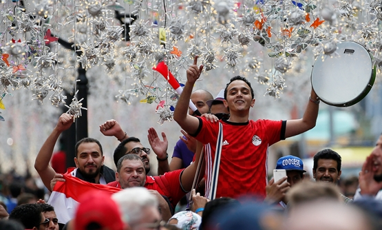 Supporters of the Egyptian national soccer team cheer during a gathering near Red Square on the eve of the 2018 FIFA World Cup in central Moscow, Russia June 13, 2018. REUTERS/Gleb Garanich