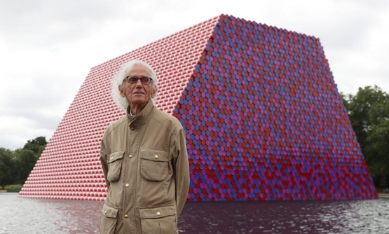 Artist Christo stands in front of his work The London Mastaba, on the Serpentine in Hyde Park, London, Britain, June 18, 2018. REUTERS/Simon Dawson