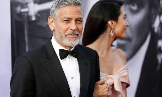 George Clooney (L) and his wife Amal -- shown here at the American Film Institute's 46th Life Achievement Award Gala Tribute to George Clooney on June 7 -- have donated $100,000 to the Young Center for Immigrant Children's Rights-GETTY IMAGES NORTH AMERIC