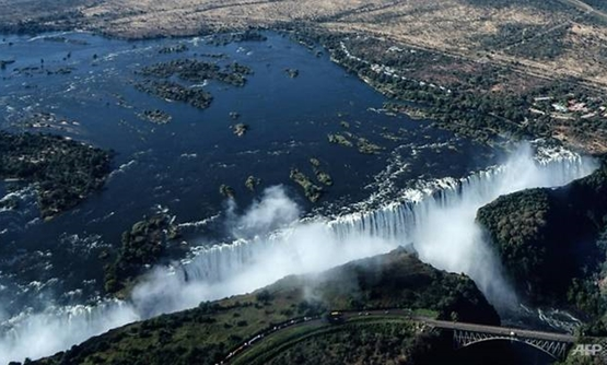 An aerial view of the Victoria Falls on the Zambezi River at the border between Zambia and Zimbabwe. Tourism accounts for around 10 percent of Zimbabwe's GDP. (Photo: AFP/Zinyange Auntony)
