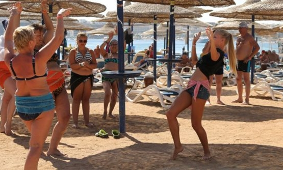 FILE- A Russian employee of a hotel teaches belly dancing to Russian tourists in Sharm el-Sheikh on Tuesday. Photograph: Asmaa Waguih/Reuters