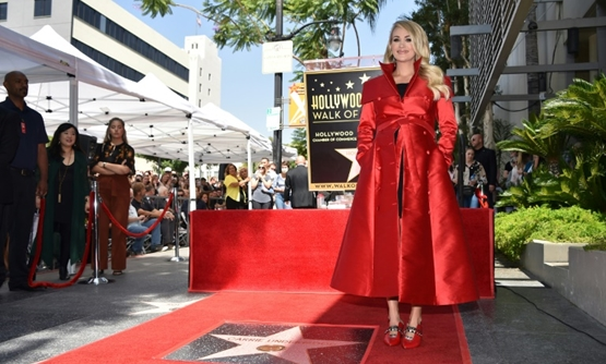 "Singer Carrie Underwood said ""belief"" was the key to her success as she received a star on the Hollywood Walk of Fame."