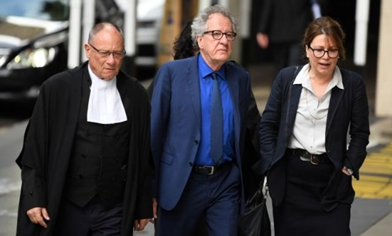 Australian actor Geoffrey Rush arrives at the Federal Court in Sydney, Australia October, 22, 2018. AAP/Dean Lewins/via REUTERS.