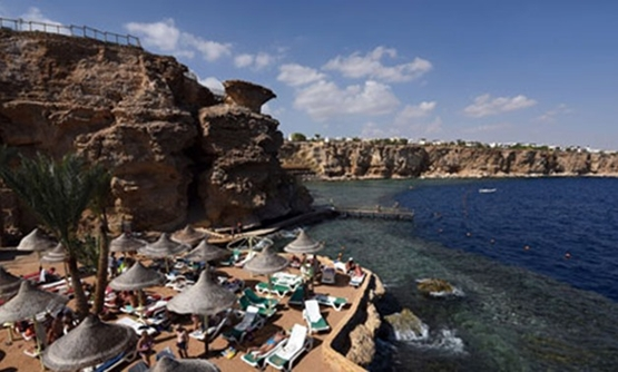 Tourists sunbathe in the Egyptian resort of Sharm el-Sheikh on November 7, 2015 – AFP