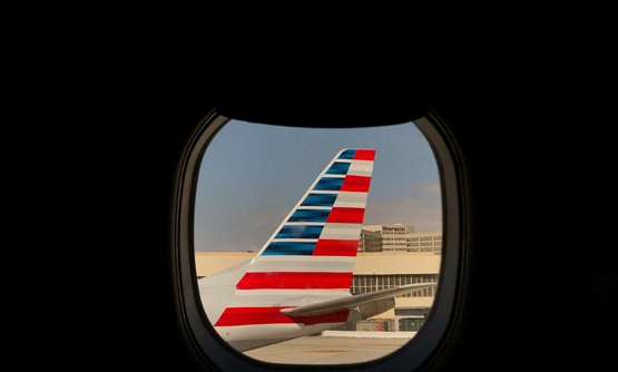 FILE PHOTO: An American Airlines airplane sits on the tarmac at LAX in Los Angeles, California, U.S., March 4, 2019. Picture taken March 4, 2019. REUTERS/Lucy Nicholson