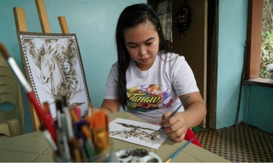 Ash from a rumbling Philippine volcano has inspired an artist and instructor to paint watercolors using the gray powder that had covered the plants in her backyard./Reuters