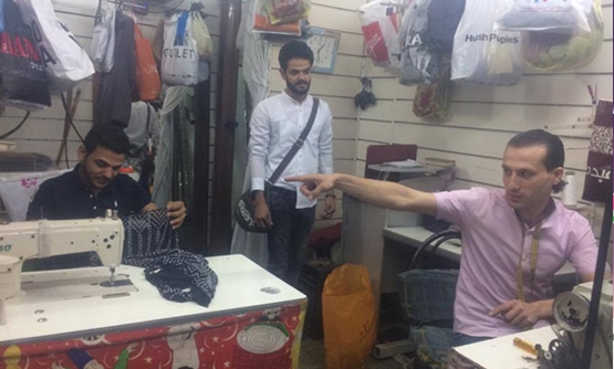 Kamel Hassan (L) at his shop in Grand Mall of Maadi- Egypt Today