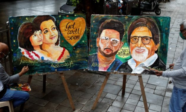 Fans in India pray for Bollywood's Bachchans to recover from COVID-19