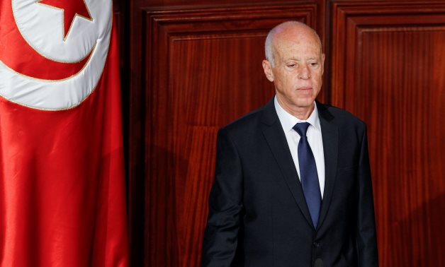 Tunisian president ousts government, freezes parliament