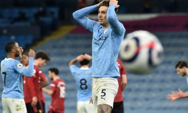 Man City march halted by United, Liverpool woes deepen