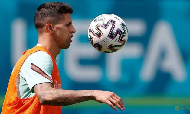 Portugal's Cancelo out of Euros due to COVID, replaced by Dalot