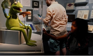 A child looks at a display of Jim Henson's Muppets character Kermit the Frog at the Museum of the Moving Image in the Queens borough of New York City, New York, U.S. July 21, 2017.