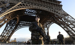 French soldiers patrol in front of the Eiffel Tower (Source: Bertrand Guay/AFP)