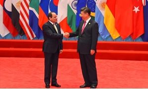 FILE - President Abdel Fatah al Sisi (L) and Chinese President Xi Jinping (R) during the G20 Summit meetings in Hangzhou, China on September 4, 2016- Press Photo