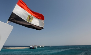 Egyptian Flag is hoisted on a mast of a sailing in the Red Sea
