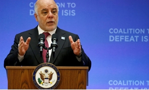 FILE PHOTO:Iraqi Prime Minister Haider al-Abadi delivers remarks at the morning ministerial plenary for the Global Coalition working to Defeat ISIS at the State Department in Washington, U.S., March 22, 2017. REUTERS/Joshua Roberts/File Photo